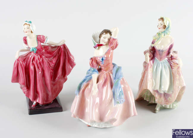 A group of three Royal Doulton figures
