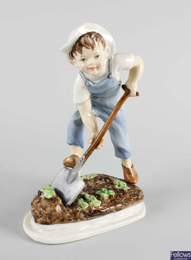 A Royal Worcester figure, 'Saturday's child works hard for a living'