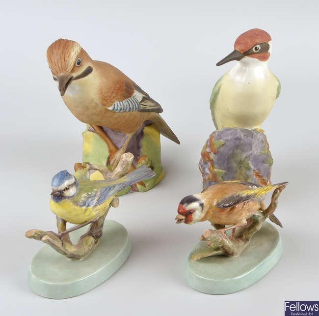 A group of twelve Royal Worcester studies of birds