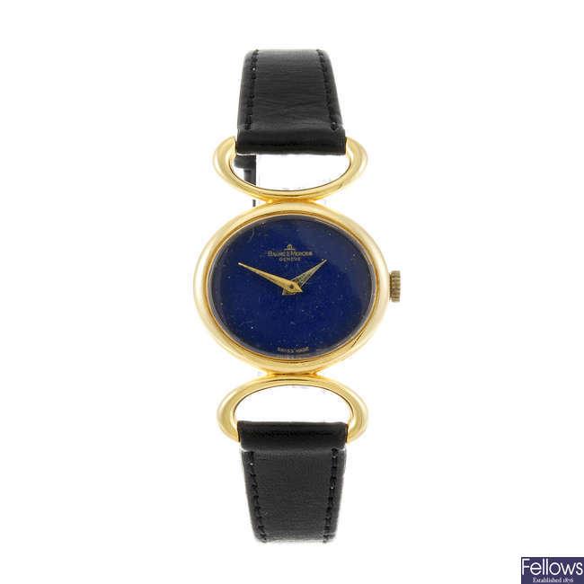 BAUME & MERCIER - a lady's yellow metal wrist watch.