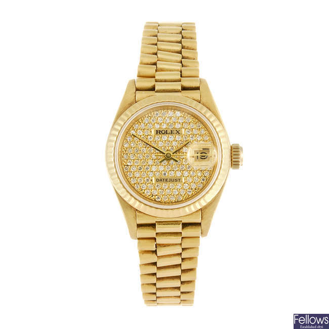 ROLEX - a lady's 18ct yellow gold Oyster Perpetual Datejust bracelet watch.