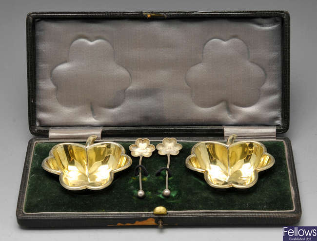 A cased set of late Victorian shamrock open salts and a single pepperette.