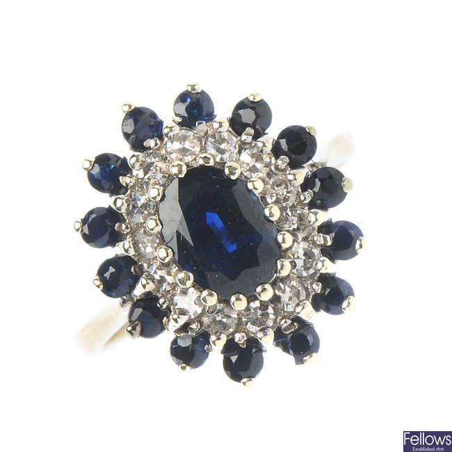 A 9ct gold sapphire and diamond cluster ring.