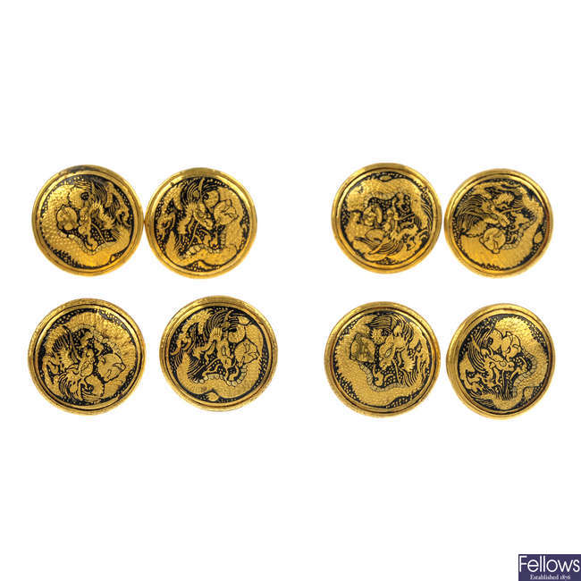 A set of eight Japanese dragon buttons.