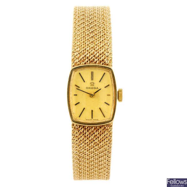 OMEGA - a lady's bracelet watch together with a wrist watch.