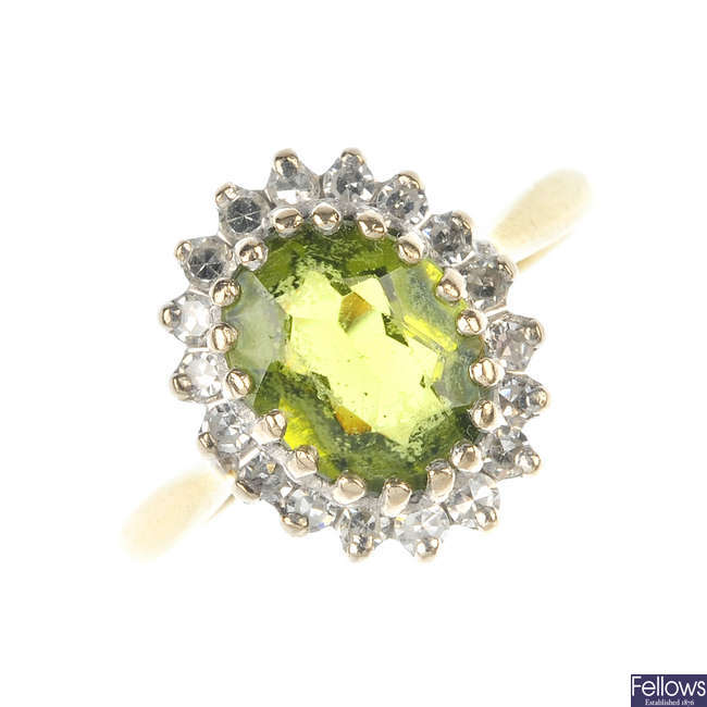 An 18ct gold peridot and diamond cluster ring.