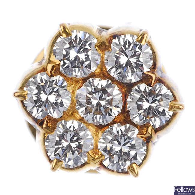 A diamond cluster dress stud.