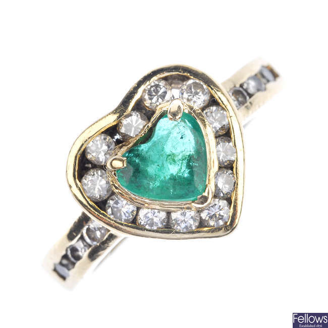 An emerald and diamond heart cluster ring.