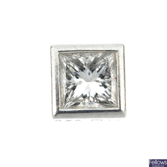 A single square-shape diamond ear stud.