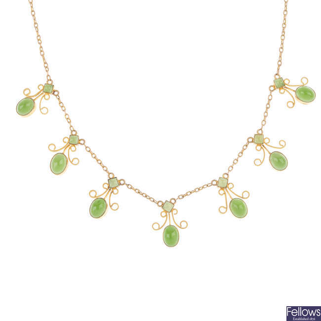 An early 20th century 9ct gold jade necklace.