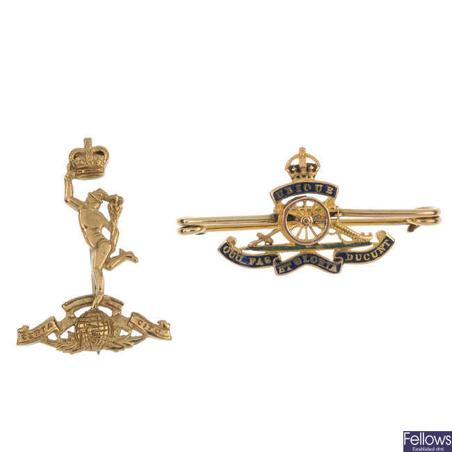 A selection of three gold Regimental and other items.