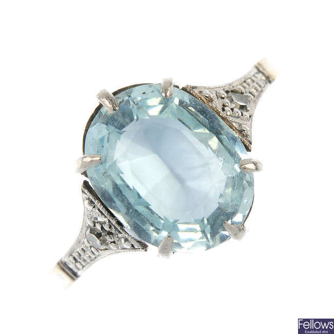 A mid 20th century platinum and gold aquamarine single-stone ring.