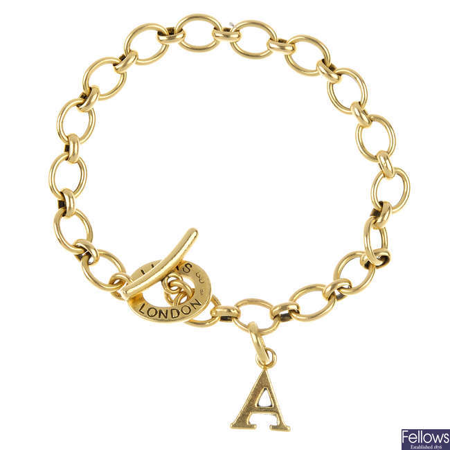 LINKS OF LONDON - an 18ct gold charm bracelet and charm.