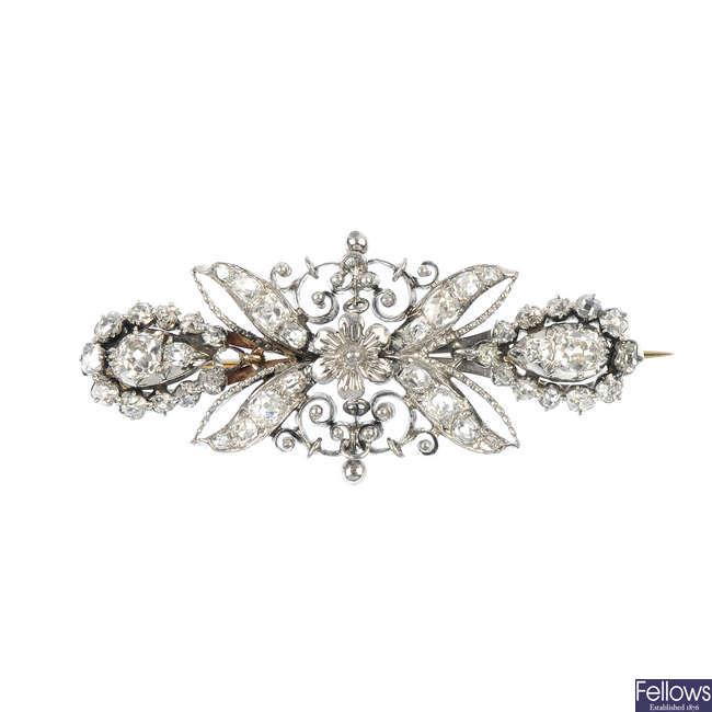 A diamond floral brooch.
