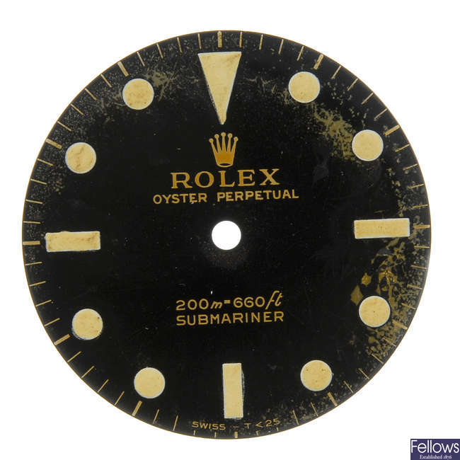 ROLEX - a gloss black Singer dial with gilt writing for a Submariner.