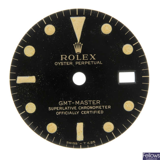 ROLEX - a gloss black Singer dial with gilt writing for a GMT-Master.