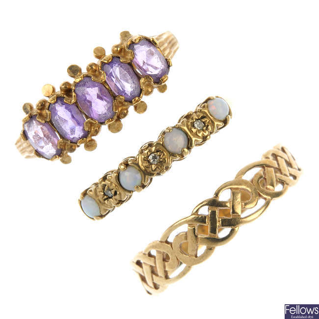 A selection of five gold dress rings.