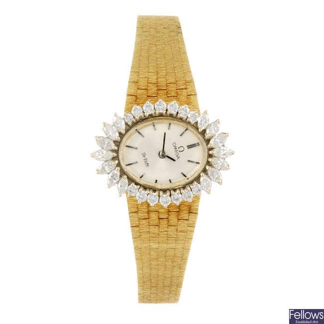 OMEGA - a lady's yellow metal De Ville bracelet watch.