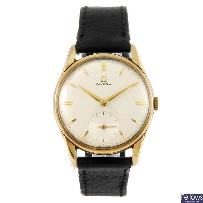OMEGA - a gentleman's 9ct gold wrist watch.