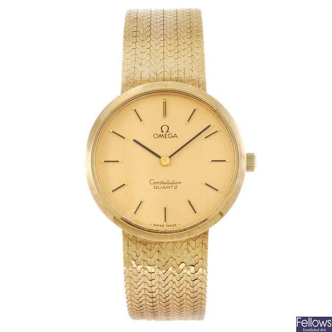 OMEGA - a gentleman's 9ct yellow gold Constellation bracelet watch.