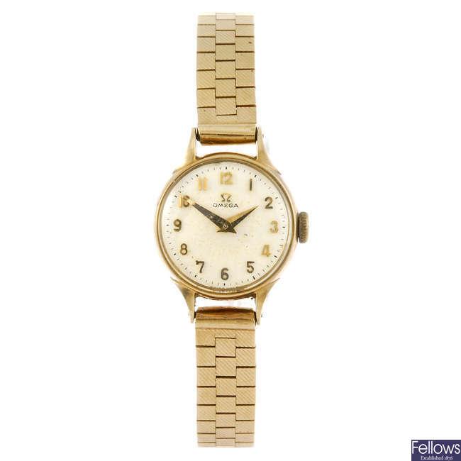 OMEGA - a lady's 9ct gold bracelet watch.