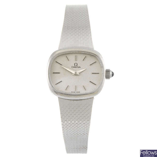 OMEGA - a lady's 9ct white gold bracelet watch.