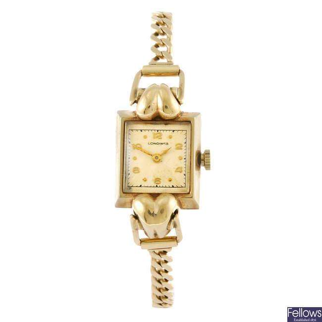 LONGINES - a lady's 9ct gold bracelet watch.