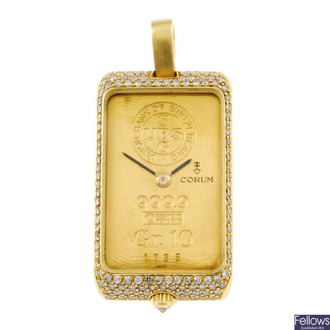 CORUM - an 18ct yellow gold and diamond set pendant watch.
