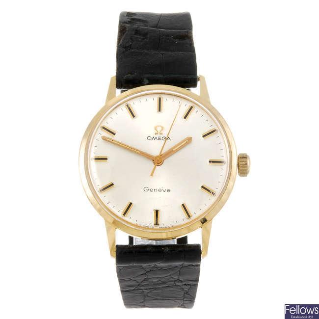 OMEGA - gentleman's yellow metal Geneve wrist watch.