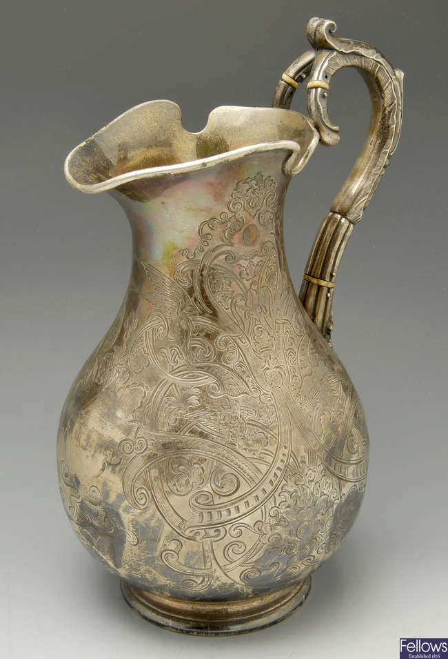 A large Victorian silver jug.