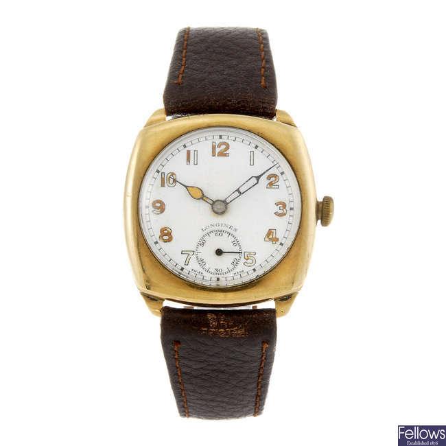 LONGINES - a gentleman's 9ct yellow gold wrist watch.