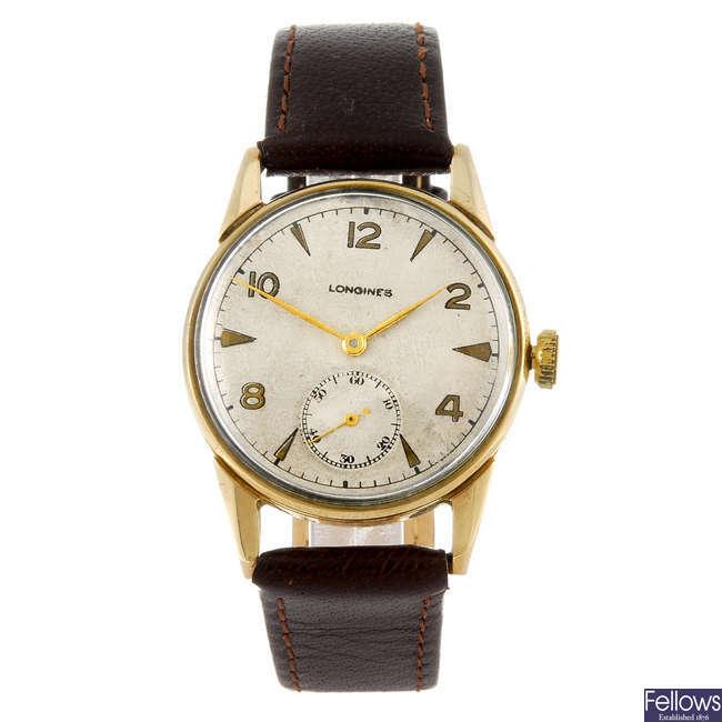 LONGINES - a gentleman's 9ct gold wrist watch.