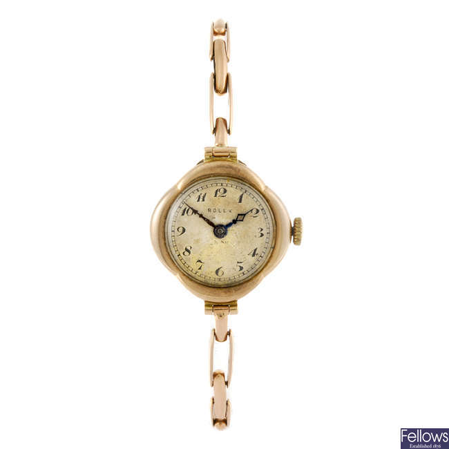 ROLEX - a lady's 9ct gold bracelet watch.