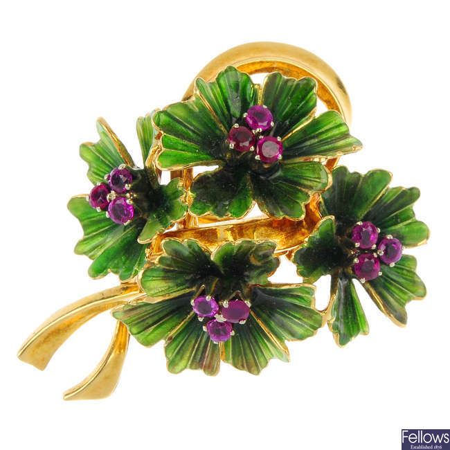 A mid 20th century 18ct gold ruby and enamel brooch.