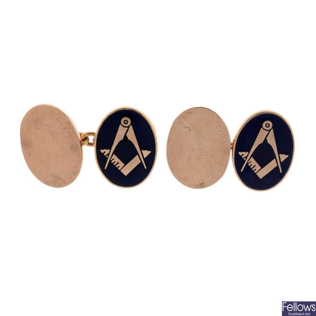 A pair of 9ct gold and enamel Masonic cufflinks.
