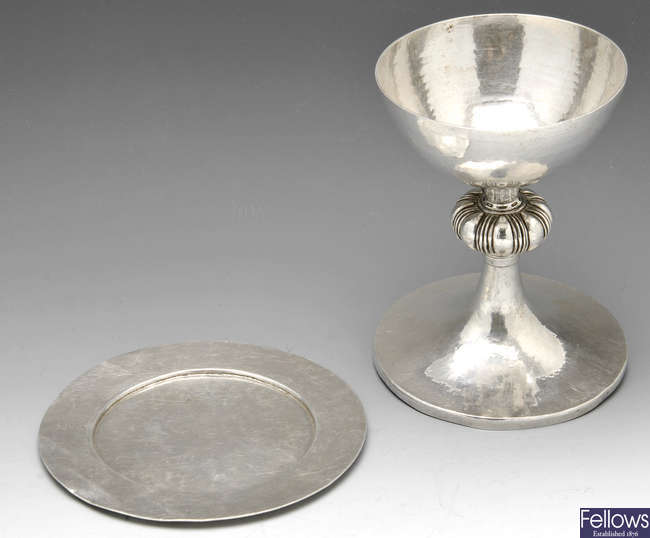 A George V silver chalice and paten.