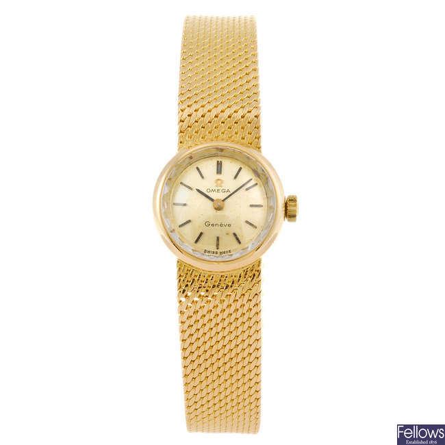 OMEGA - a yellow metal lady's Geneve bracelet watch.
