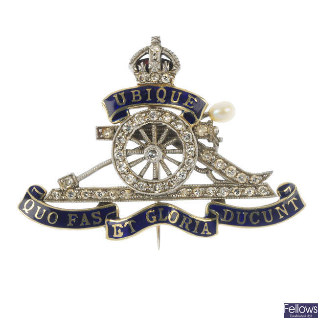 A mid 20th century 18ct gold and platinum diamond and enamel Royal Artillery brooch.