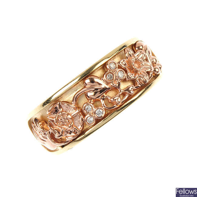 CLOGAU- a 9ct gold and diamond floral band ring.