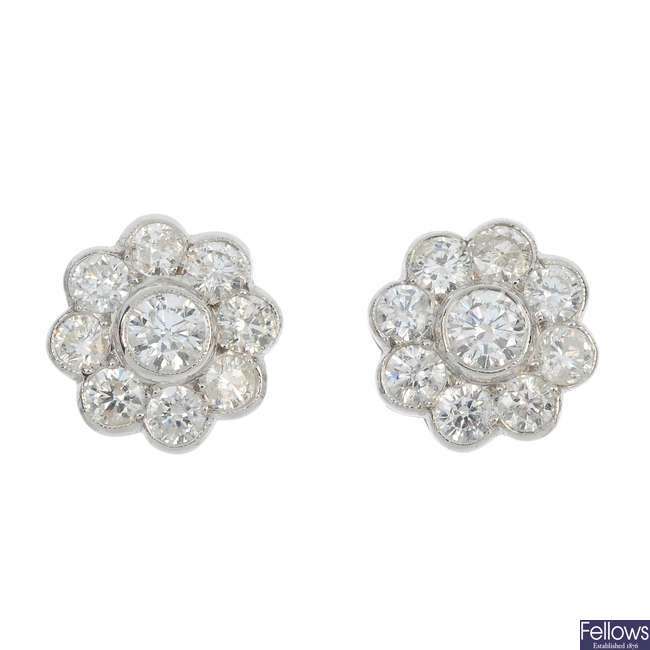 A pair of diamond cluster ear studs.