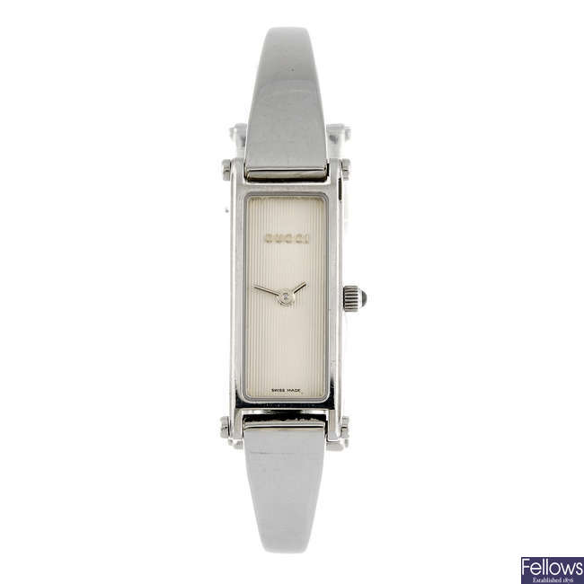 GUCCI - a lady's 1500L bangle watch.