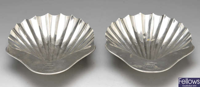 A pair of George III silver shell butter dishes.