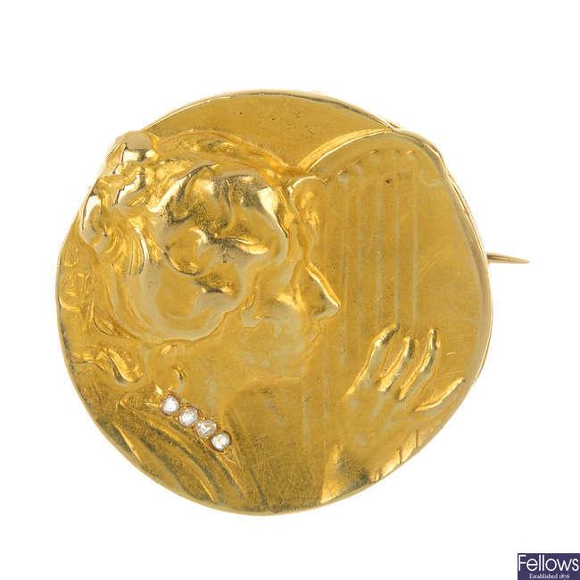 An Art Nouveau gold diamond medallist brooch.