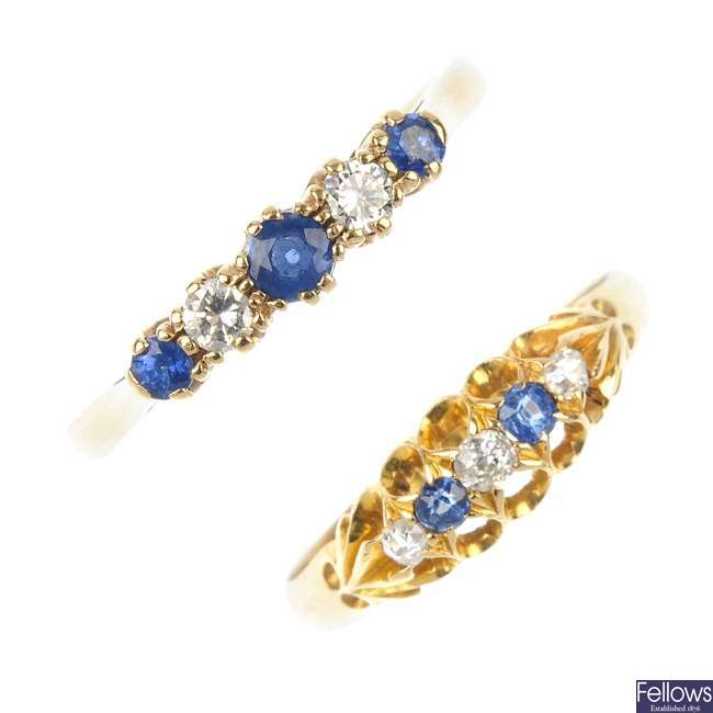 Two gold sapphire and diamond five-stone rings.