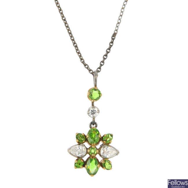 A demantoid garnet and diamond pendant.