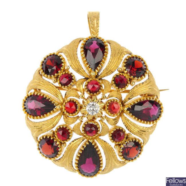 A diamond and garnet pendant.