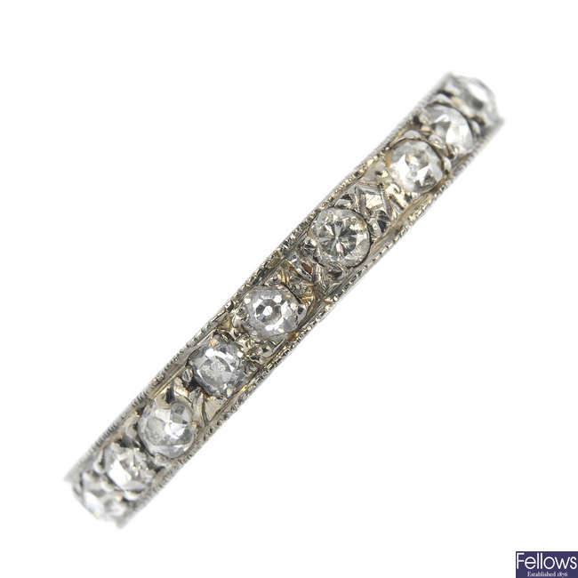 An early 20th century platinum and diamond full-circle eternity ring.