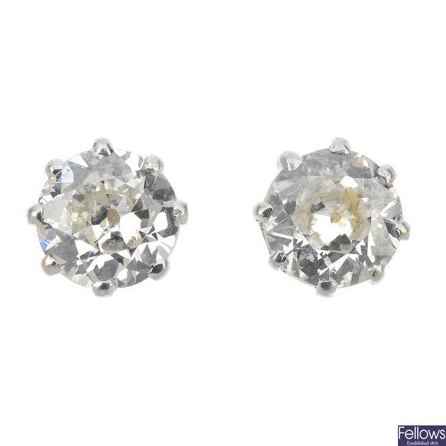 A pair of circular-cut diamond ear studs.