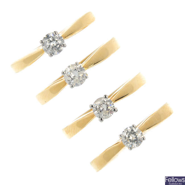 A selection of four 18ct gold diamond rings.