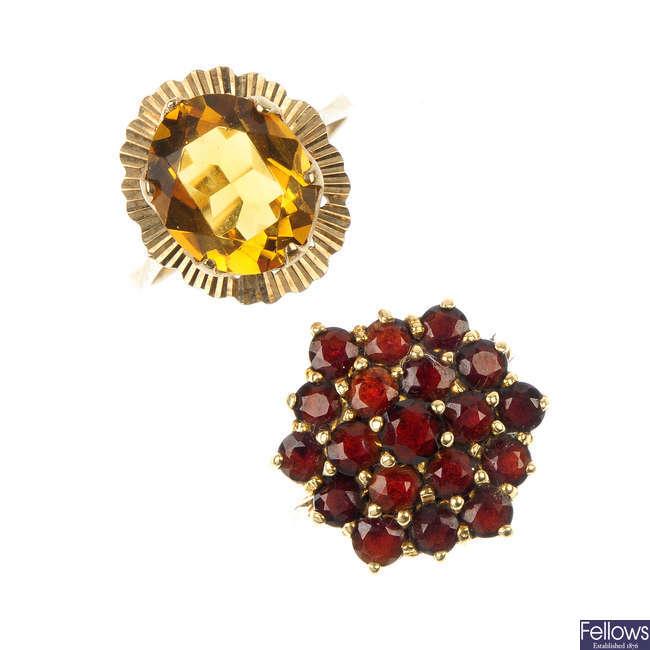 An assortment of four 9ct gold gem-set rings.